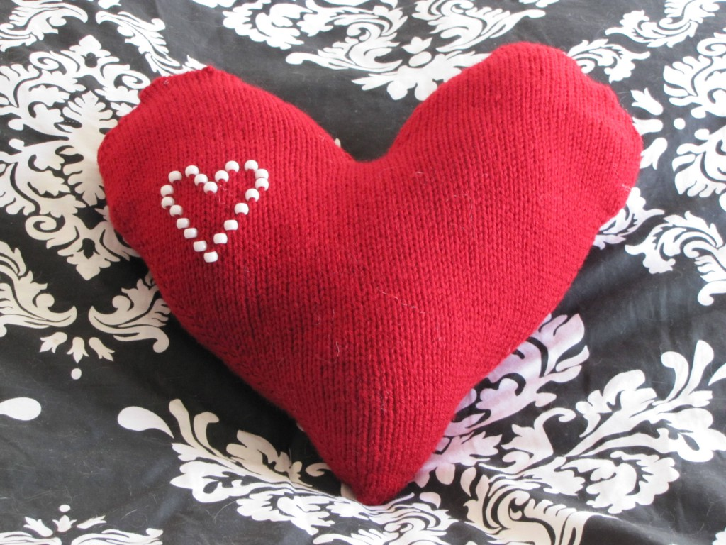 Hand knit beaded heart pillow