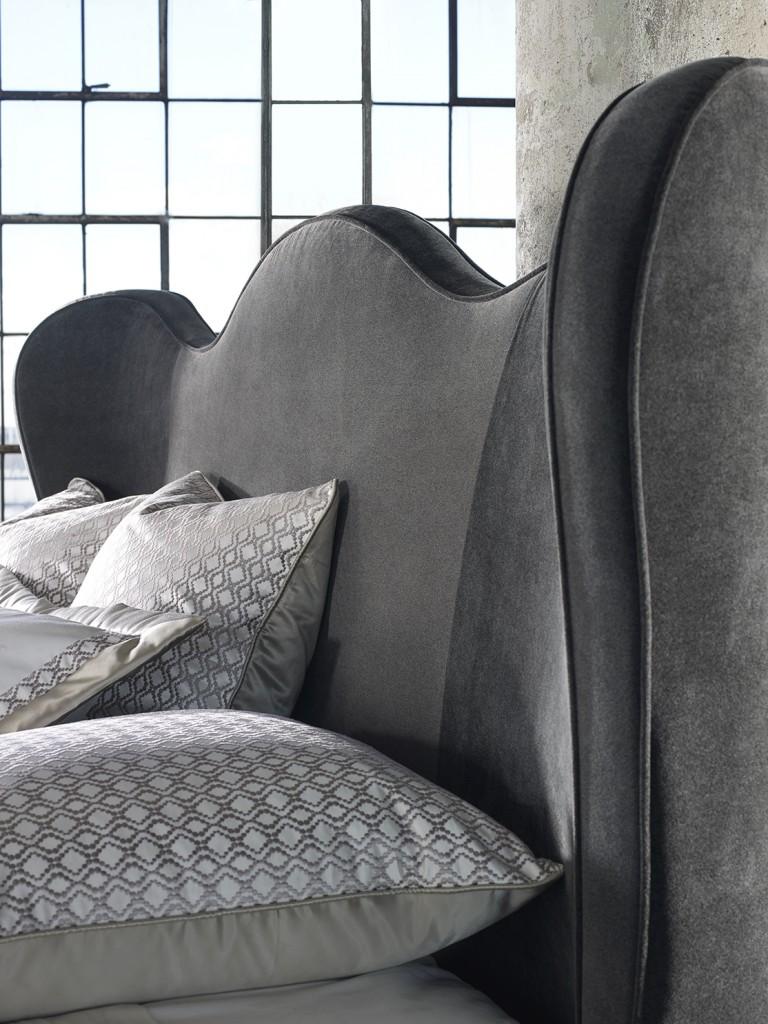 Lana bed has exaggerated shelter headboard