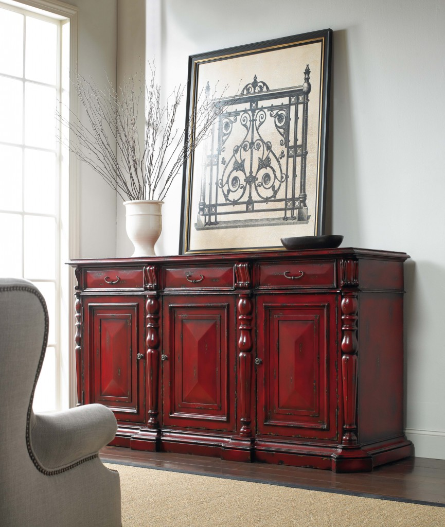 The Red Credenza Is A Bold Piece To Greet Guests.