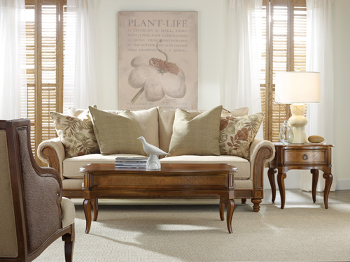 Hooker's Windward sofa covered in a honey-colored fabric is a key part of this room's relaxed, welcoming appeal.