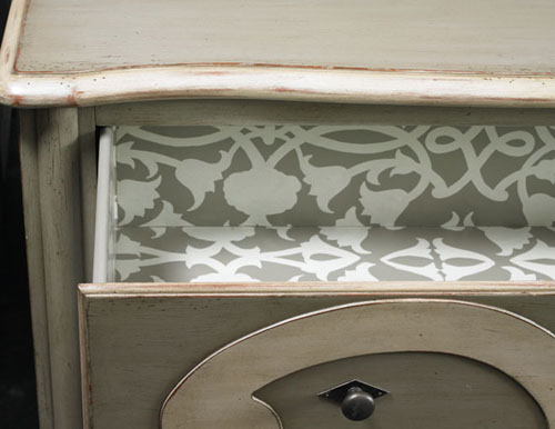 A foliage pattern in lively white on gray gives this well-worn chest a modern vibe.
