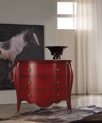 This shapely red drawer chest may be a show-stopper for the holidays, but it's also got a secret inside!