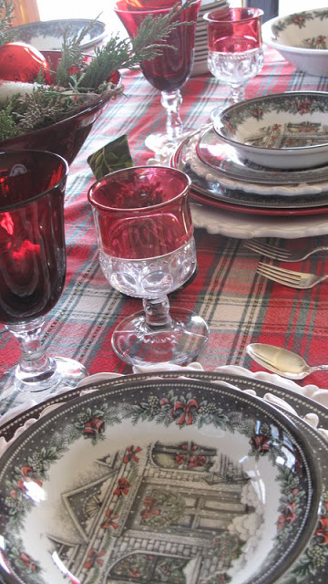Plaid brings out the colors in this unique glassware and china. / Image credit: redcouchrecipes.blogspot.com