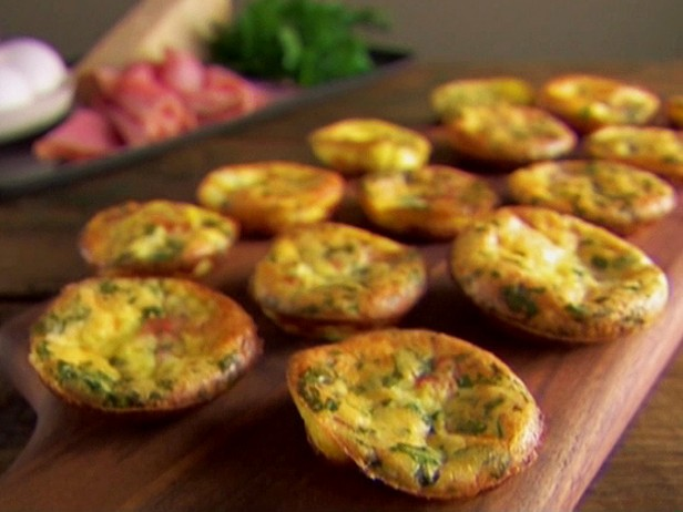 Mini Frittatas would be delicious with a warm scone or muffin.  A quick recipe from Giada De Laurentiis