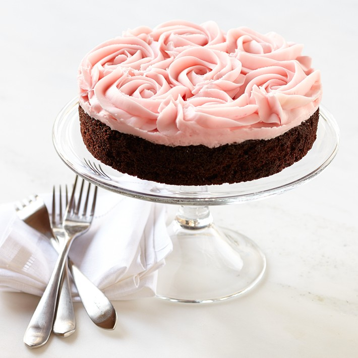 Rose-topped cake is yummy and decorative.