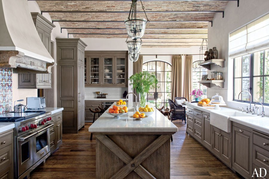 With a warm, inviting kitchen like this, who cares whether Tom and Gisele can even cook?  We just want to hang out there.