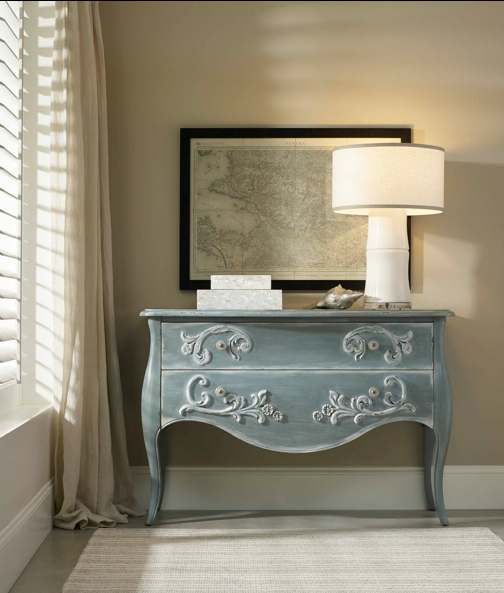 A washed blue finish imparts a soft romantic sensibility to this shapely two-drawer chest.