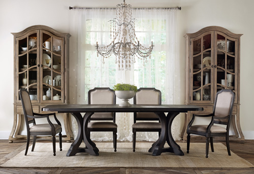 Corsica's pedestal dining table and Belgian display cabinet