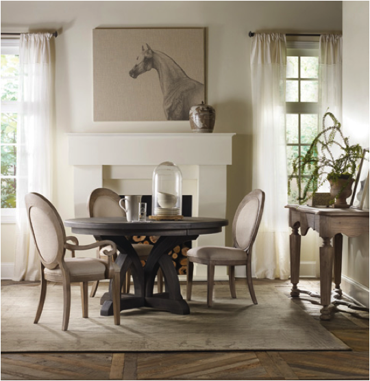 The oval back arm chair and side chair complete the dining room