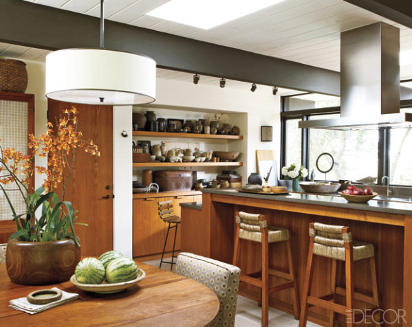Materials like teak and concrete ground this space in a palette derived from nature. Credit: Laura Resen, ElleDecor.com