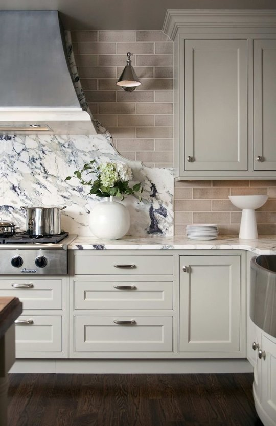 I'm drawn to light tones of blue, green and gray in the kitchen. Photo credit: Decorpad.com