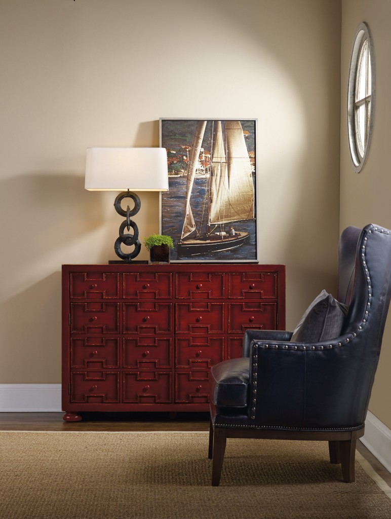 red chest with wing chair, lamp and sailboat pic